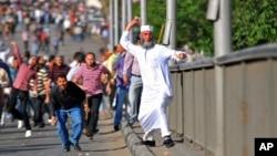 Các người biểu tình của cả 2 phía ở Ai Cập cáo buộc các nhiếp ảnh gia là người của phía bên kia
