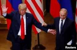 FILE - U.S. President Donald Trump and Russian President Vladimir Putin react at the end of the joint news conference after their meeting in Helsinki, Finland, July 16, 2018.