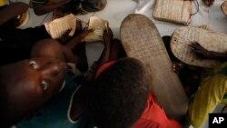 Des élèves dans une école coranique à Dakar, au Sénégal, le 31 août 2010.
