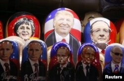 FILE - Painted matryoshka dolls, or Russian nesting dolls, bearing the faces of then-U.S. Republican presidential nominee Donald Trump and Russian President Vladimir Putin are displayed at a souvenir shop in central Moscow, Russia, Nov. 7, 2016.
