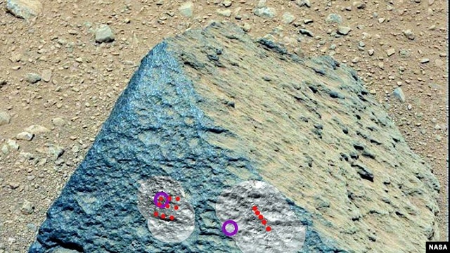 "This image shows where NASA's Curiosity rover aimed two different instruments to study a rock known as ""Jake Matijevic."" (NASA/JPL-Caltech/MSSS)"