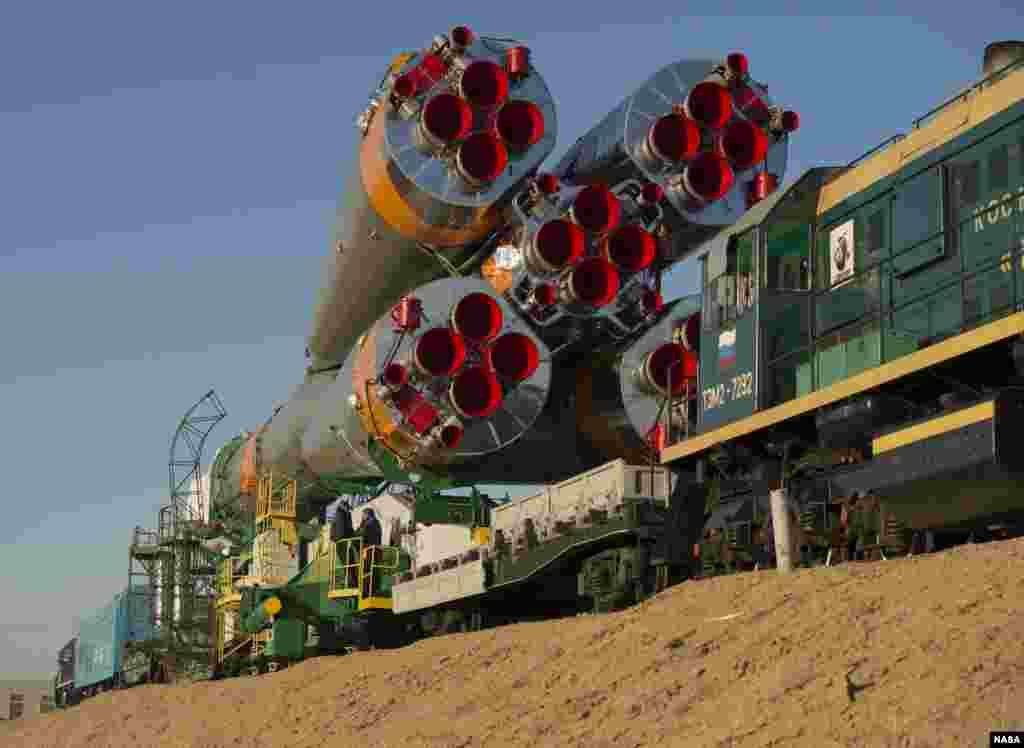 The Soyuz rocket is rolled out to the launch pad by train at the Baikonur Cosmodrome in Kazakhstan, (NASA/Carla Cioffi).