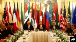 Russia's Foreign Minister Sergei Lavrov, top right, U.S. Secretary of State John Kerry, top center, and other foreign ministers attend a meeting in Vienna, Austria, Nov. 14, 2015, to find a way to resolve the conflict in Syria.