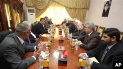 Representatives of Shi'ite cleric Muqtada al-Sadr and Iraqi Prime Minister Nouri al-Maliki's political parties meet in Baghdad, 01 Oct 2010