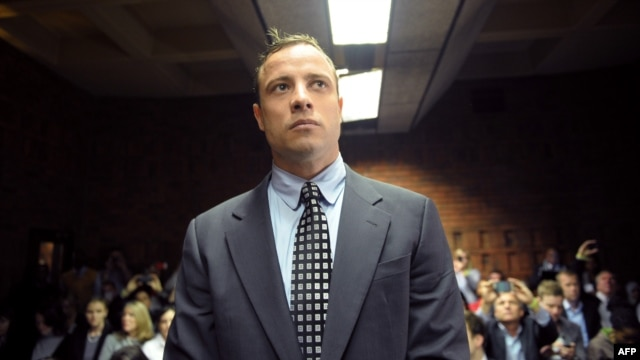 FILE - South African Paralympic sprinter Oscar Pistorius appearing at Magistrate Court in Pretoria.