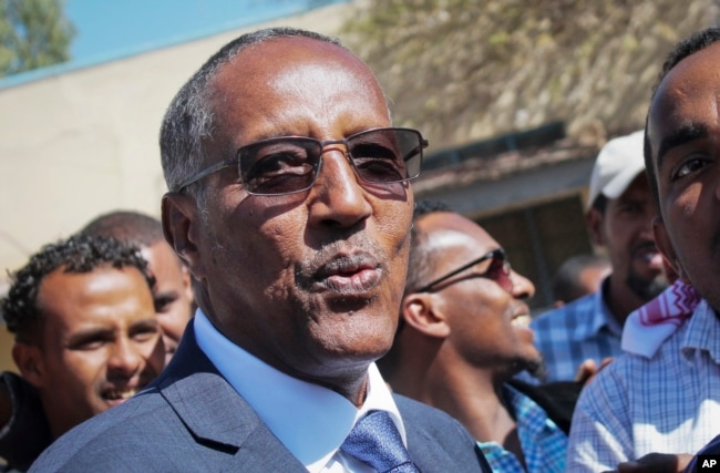 Ruling party candidate Muse Bihi Abdi speaks to the media after casting his vote in the presidential election in Hargeisa, Somaliland, Nov. 13, 2017.