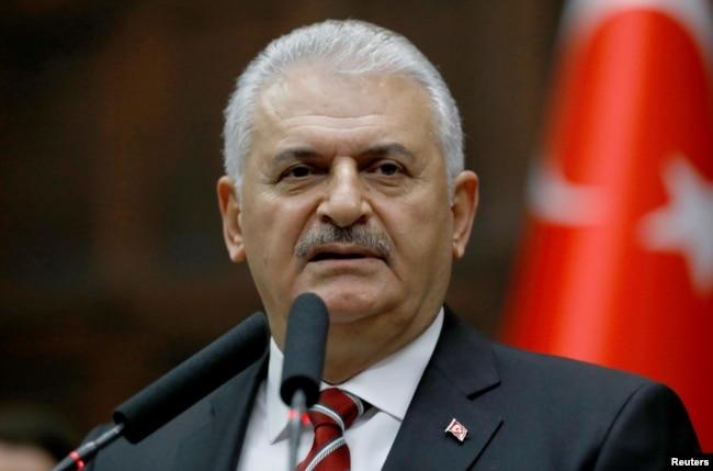 Prime Minister Binali Yildirim addresses members of parliament at the Turkish parliament in Ankara, Nov. 8, 2016.