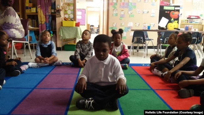 Students take part in the Mindful Moment Program in Baltimore, Maryland.