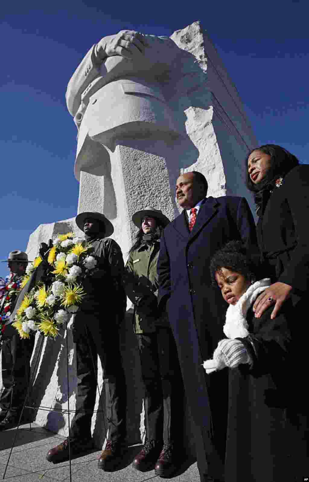 Martin Luther King III, center, the son of civil rights leader Martin Luther King Jr., at a wreath laying ceremony at the Martin Luther King, Jr. Memorial, in Washington, in observance of King's 83rd birthday anniversary, January 15, 2012. (AP)