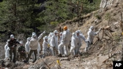 French emergency rescue services work among debris of the Germanwings passenger jet at the crash site near Seyne-les-Alpes, France, April 3, 2015.