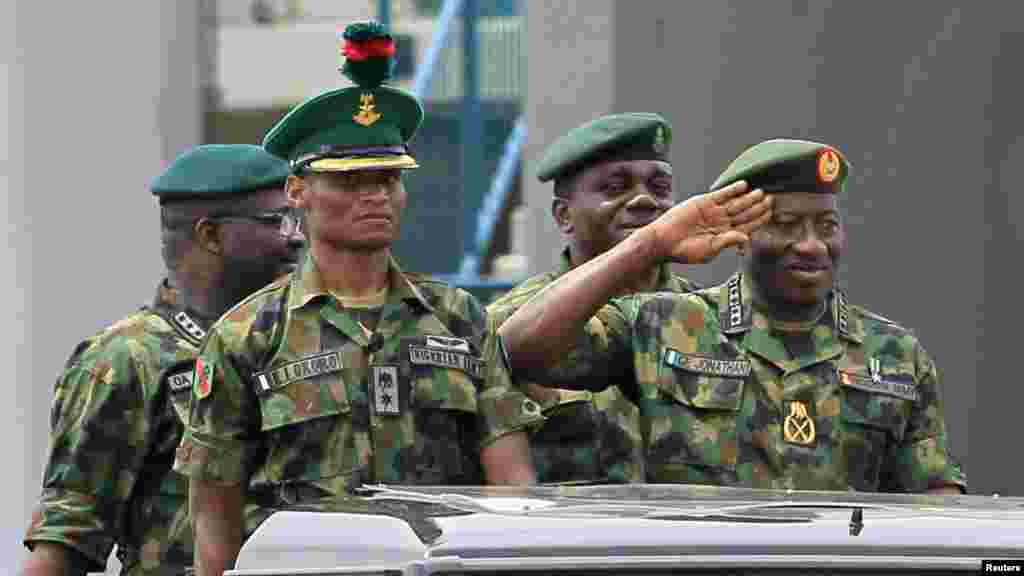 President Jonathan salutes as he parades during the Nigeria Army's 150th anniversary celebration.