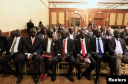 FILE - Members of South Sudan rebel delegation attend the opening ceremony of South Sudan's negotiation in Ethiopia's capital Addis Ababa, Jan. 4, 2014.