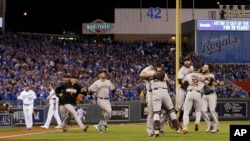 San Francisco Giants players celebrate after Game 7 of baseball's World Series against the Kansas City Royals Wednesday, Oct. 29, 2014.