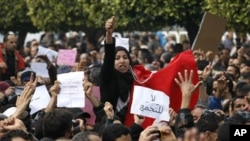 Protesters shout slogans during a demonstration in the center of Tunis, 19 January 2011.