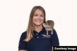 American researcher Ellie Cutright with an African giant pounched rat. She trains them to find underground explosives.