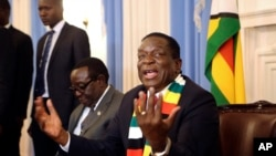 FILE - Zimbabwean President elect Emmerson Mnangagwa addresses a press conference in Harare, Aug, 3, 2018.