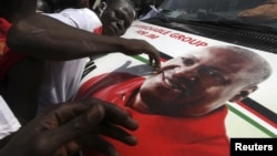 National Democratic Congress (NDC) party supporters celebrate the victory of their candidate, John Dramani Mahama, in Accra, December 9, 2012.