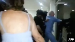 FILE - A screen grab from cellphone footage shows opposition leader Antonio Ledezma being taken away from his home forcibly by the intelligence service while still wearing pajamas, in Caracas, July 31, 2017.