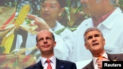 FILE - Juergen Hambrecht (R), CEO of German chemical company BASF, poses with CFO Kurt Bock during the annual news conference in Ludwigshafen, Germany.