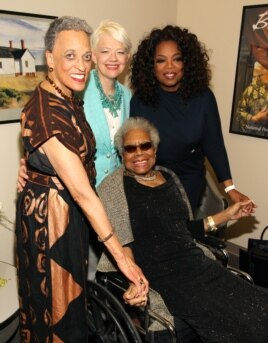 FILE: At Maya Angelou's portrait unveiling at the Smithsonian's National Portrait Gallery, the writer, seated, is joined by, from left, National African Art Museum director Johnnetta Cole, National Portrait Gallery director Kim Sajet and Oprah Winfrey in Washington, D.C., in April 2014.