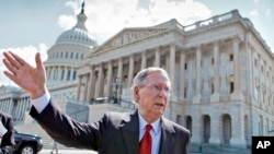 FILE - Republican Senate Majority Leader Mitch McConnell, stands outside of the U.S. Capitol in Washington, July 23, 2013. Analysts say Democrats could reclaim control of the Senate, but face an uphill fight in the House Representatives.