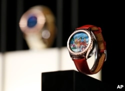 FILE - Samsung Gear S2 Classic smart watches are on display during a Samsung news conference at CES Press Day at CES International, Jan. 5, 2016, in Las Vegas. The flexible sensor developed at UC Berkeley can be made into wristbands or headbands that provide continuous, real-time analysis of the chemicals in sweat. In the NIH project, volunteers will help take exams beyond the standards, to include even day-to-day wellness information gathered from smartphones or wearable sensors.