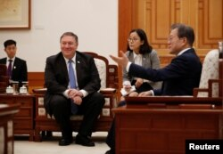 U.S. Secretary of State Mike Pompeo looks on as he attends a bilateral meeting with South Korea's President Moon Jae-in at the presidential Blue House in Seoul, South Korea, June 14, 2018.