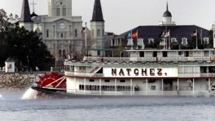 The New Orleans skyline shows St. Louis Cathedral, left, the Presbyterian Building, right, and the Natchez paddle boat headed down the foggy Mississippi River, Saturday, Dec. 31, 2005. New Orleans has a New Year's Eve celebration scheduled in the Jackson Square area with music including Arlo Guthrie and family and fireworks. (AP Photo/Judi Bottoni)