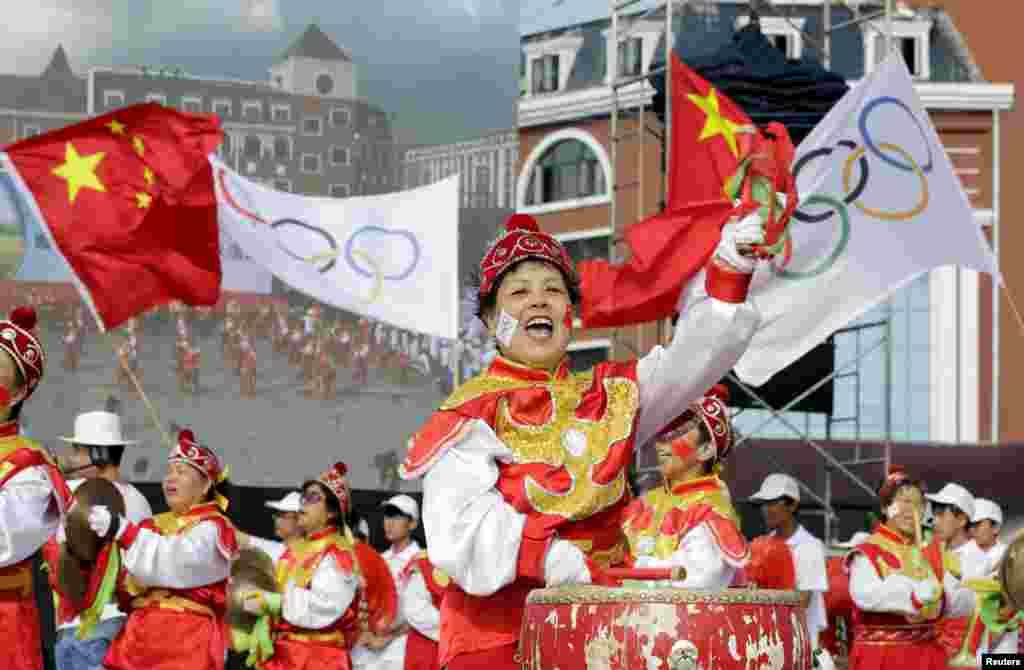 Local residents perform ahead of the International Olympic Committee's announcement of the winning city for the 2022 Winter Olympics bid, at a square in Chongli county of Zhangjiakou, jointly bidding to host the Games with China's capital, Beijing.  Beijing becomes the first city to be awarded both summer and winter Games.