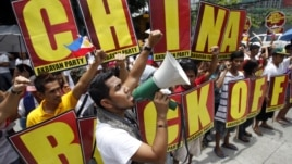 Filipinos chant anti-China slogans over the disputed Scarborough Shoal islands in the South China Sea claimed by both nations as they march toward the Chinese consulate in the Makati financial district of Manila, Philippines, May 11, 2012.