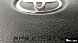 The steering wheel of a Toyota car which contains an airbag is pictured in Vienna, April 11, 2013.