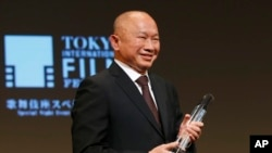 Hong Kong director John Woo smiles during the awarding ceremony of Samurai Award at the 28th Tokyo International Film Festival in Tokyo Monday, Oct. 26, 2015.