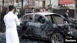 Hiện trường 1 vụ đánh bom xe ở Baghdad, 18/9/2013. Liên Hiệp Quốc cho biết hơn 4.000 người đã thiệt mạng trong khoảng thời gian từ tháng tư đến tháng tám năm nay.
