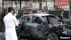 Hiện trường một vụ tấn công bằng bom xe ở Iraq, ngày 18/9/2013.