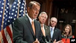 House Speaker John Boehner of Ohio, left, speaks during a news conference on Capitol Hill in Washington, Sept. 9, 2014.