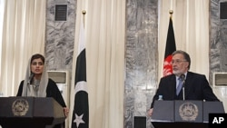 Pakistan Foreign Minister Hina Rabbani Khar, left, speaks during a joint press conference with her Afghan counterpart Zalmai Rasool at the foreign ministry in Kabul, Afghanistan, February 1, 2012.
