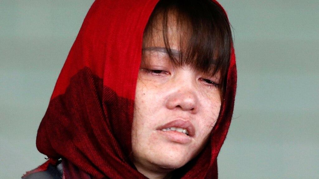 Cô Đoàn Thị Hương lúc bị dẫn giải ra khỏi tòa hôm 14/3.