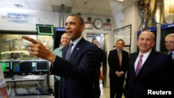 U.S. President Barack Obama tours the Argonne National Lab near Chicago, March 15, 2013. Obama traveled to Chicago on Friday for an event where he will propose diverting $2 billion in revenue from federal oil and gas leases to pay for research on advanced