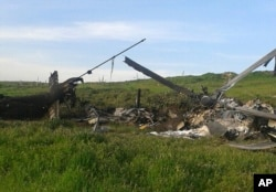 Remains of a downed Azerbaijani forces helicopter lie in a field in the separatist Nagorno-Karabakh region, April 2, 2016.