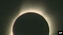 The sun's corona, or outer atmosphere, is visible during totality when the sun is totally obscured by the moon's shadow, 28 Mar 2008