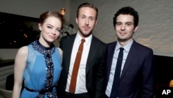 "FILE - Emma Stone, Ryan Gosling and writer/director Damien Chazelle seen at the Los Angeles Premiere of ""La La Land"" afterparty at Village Theatre in Los Angeles, Dec. 6, 2016."