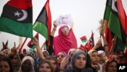 Libyan women celebrate the revolution against Moammar Gadhafi's regime and demand more rights.