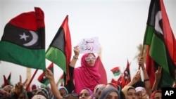 Libyan women celebrate the revolution against Moammar Gadhafi's regime in 2011.