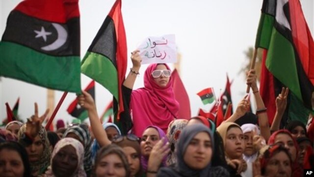 FILE - Libyan women celebrate the revolution against Moammar Gadhafi's regime at a rally in Tripoli, September 2, 2011.