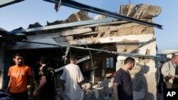 BMTning Jebaliya qochqinlar lageridagi maktabi Isroil hujumidan so'ng, G'aso Sektori, 30-iyul, 2014-yil
