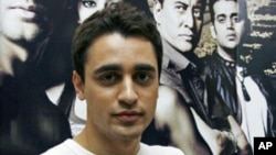 Bollywood actor Imran Khan poses for a picture during a promotional event for his forthcoming movie 'Luck' at a radio station in Mumbai, July 20, 2009