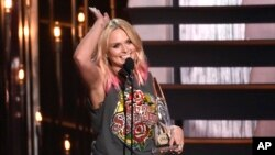 Miranda Lambert accepts the award for female vocalist of the year at the 49th annual CMA Awards at the Bridgestone Arena on Wednesday, Nov. 4, 2015, in Nashville, Tenn. (Photo by Chris Pizzello/Invision/AP)