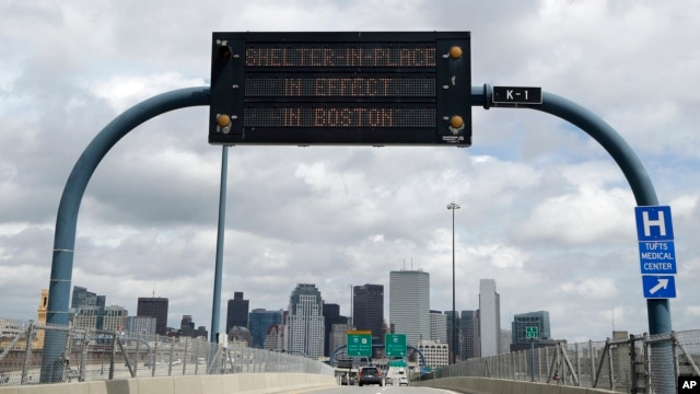 "A sign calling for citizens of Boston to ""Shelter in Place"" is shown on I-93 in Boston on April 19, 2013."