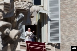 Pope Francis delivers his speech during the Angelus noon prayer he delivered from the window of his studio overlooking St. Peter's Square at the Vatican, Jan. 1, 2015.