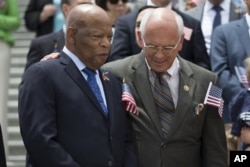 Rep. Paul Tonko, right, puts his arm around Rep. John Lewis.